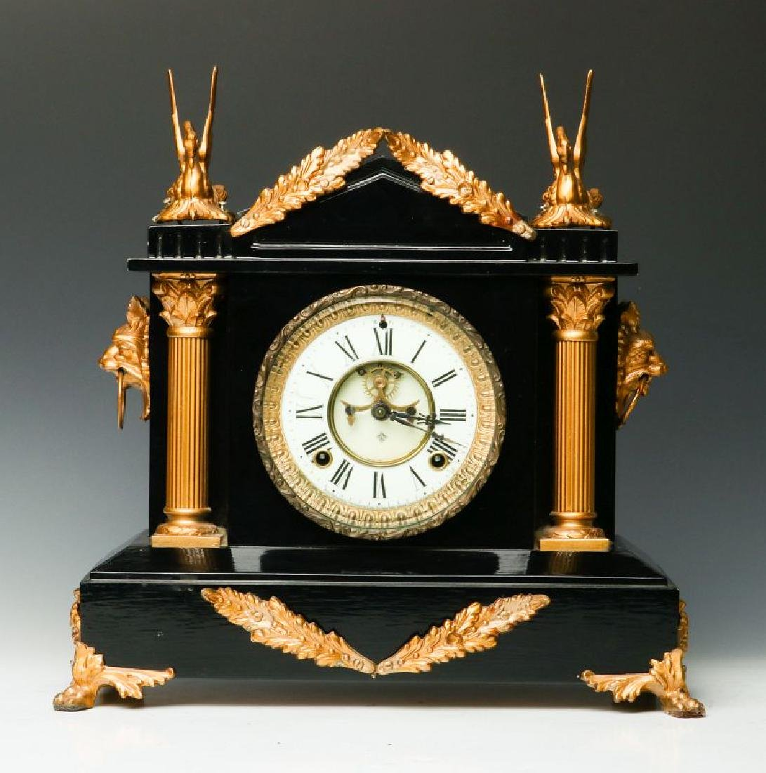 AN ANSONIA ENAMELED IRON CLOCK WITH SWANS