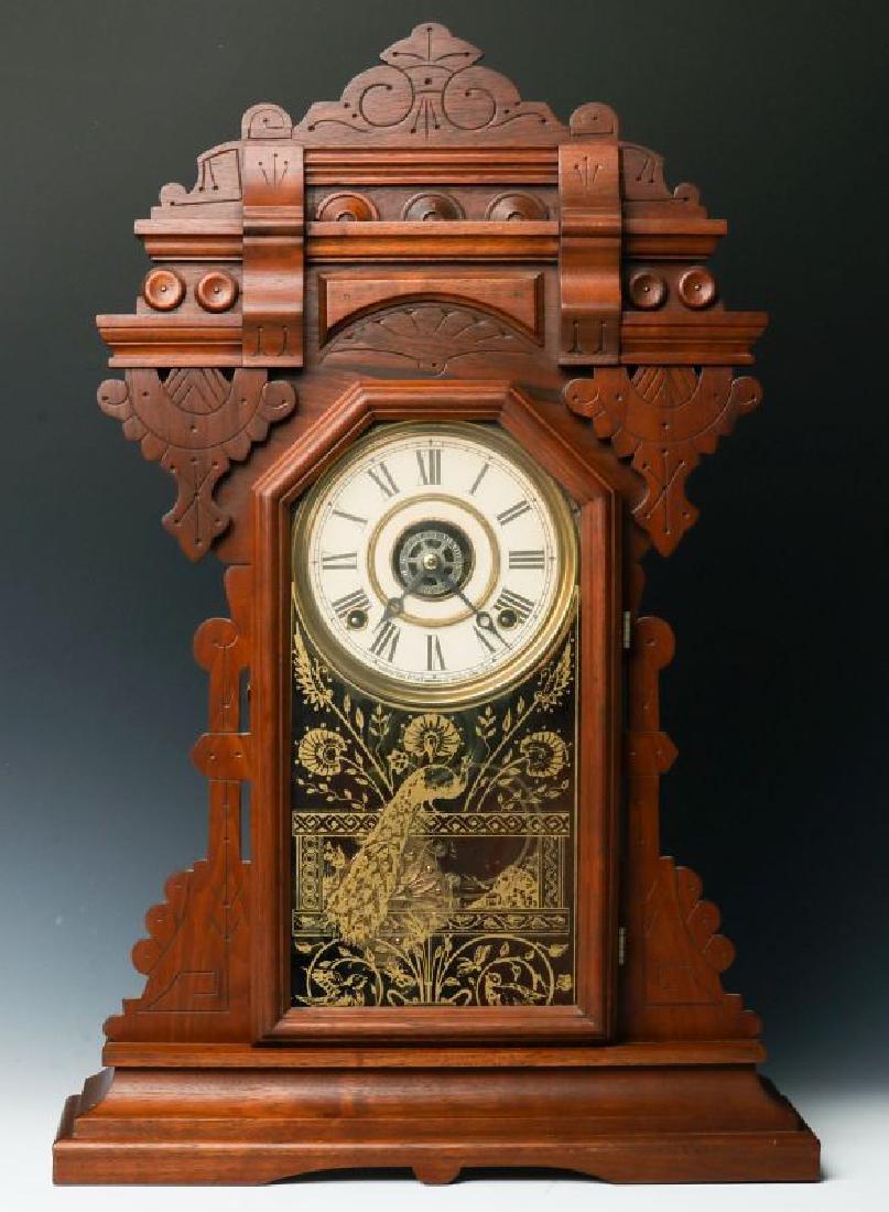 AN INGRAHAM ORNATE WALNUT PARLOR CLOCK