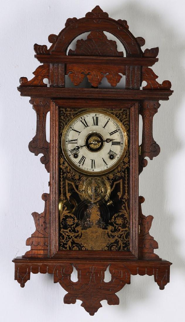 AN E.N. WELCH ORNATE WALNUT HANGING PARLOR CLOCK