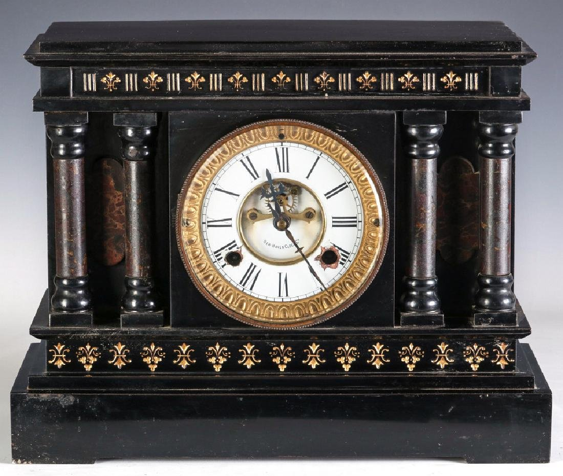 A NEW HAVEN ENAMELED IRON MANTLE CLOCK