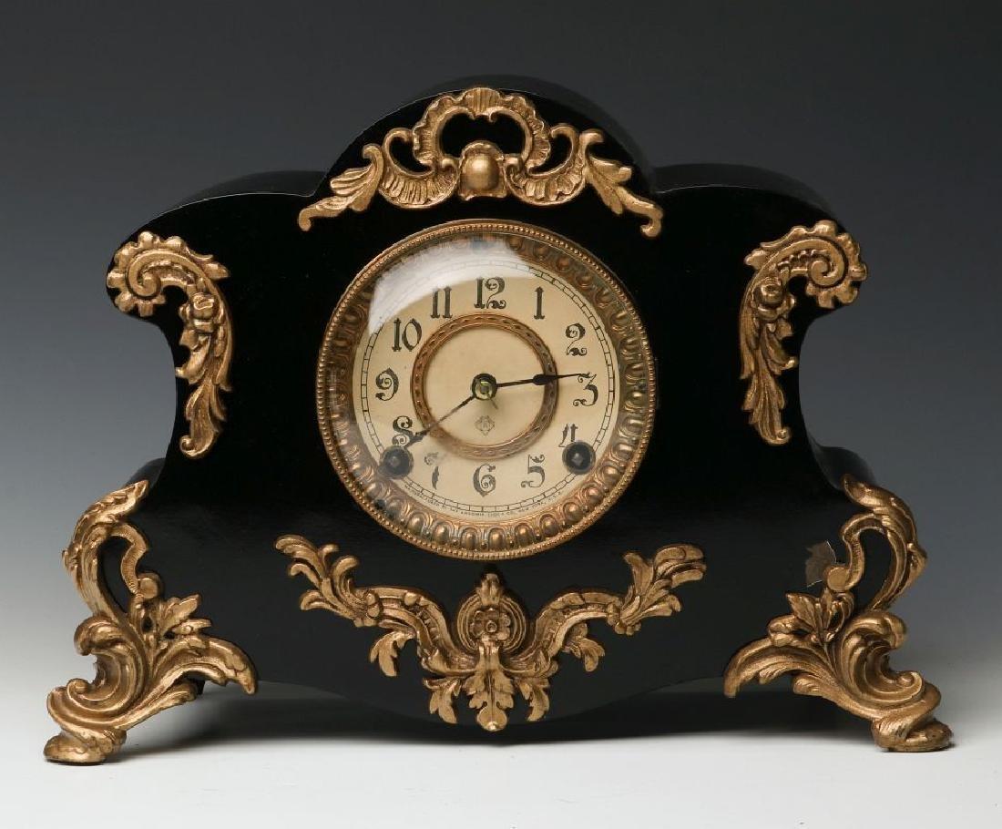 AN ANSONIA 'AMIENS' IRON MANTLE CLOCK