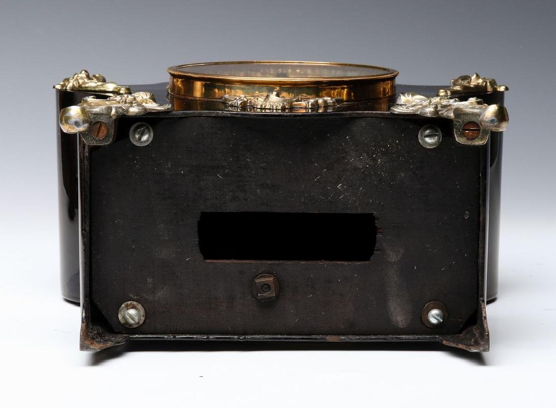 AN ANSONIA BLACK ENAMELED SHELF CLOCK - 15