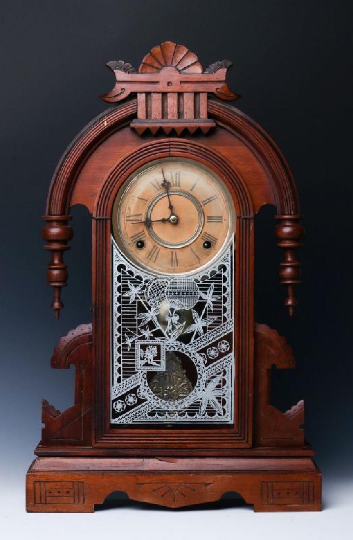 A GILBERT WALNUT TEARDROP PARLOR CLOCK