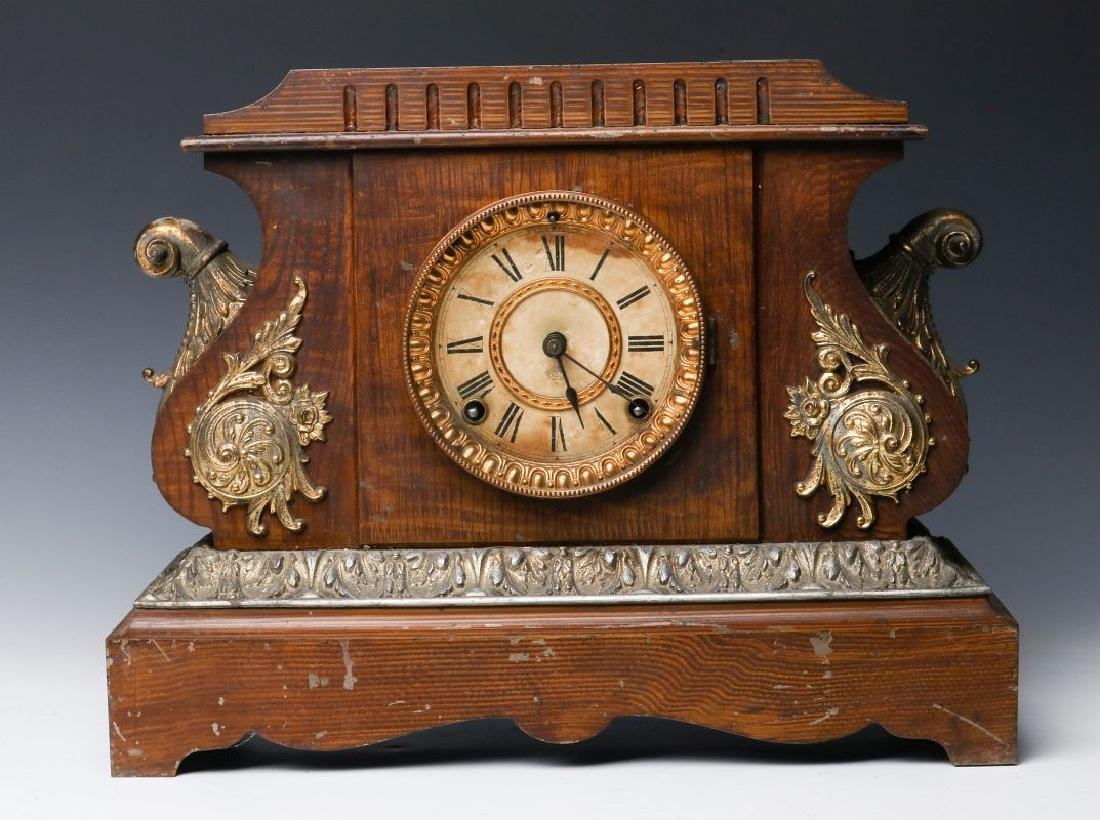 A GRAIN PAINTED IRON CASE ANSONIA MANTLE CLOCK