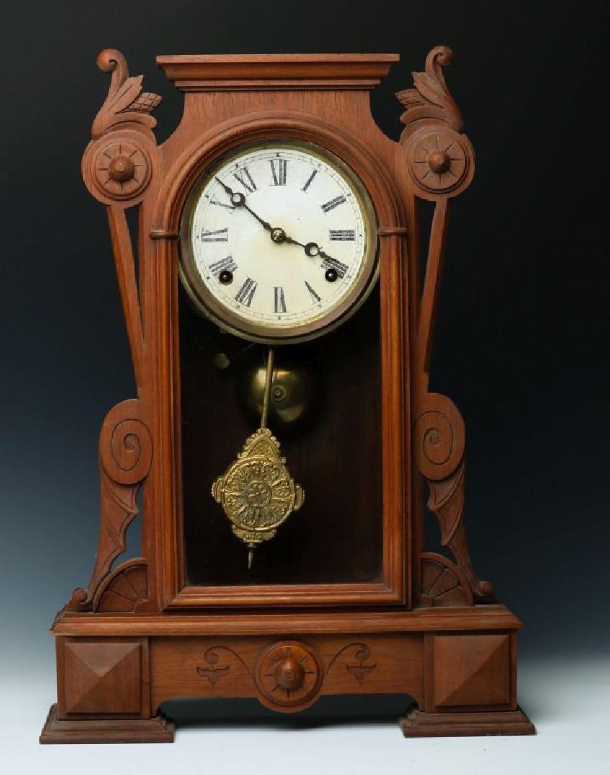 A VICTORIAN WALNUT PARLOR CLOCK ATTRIBUTED KROEBER