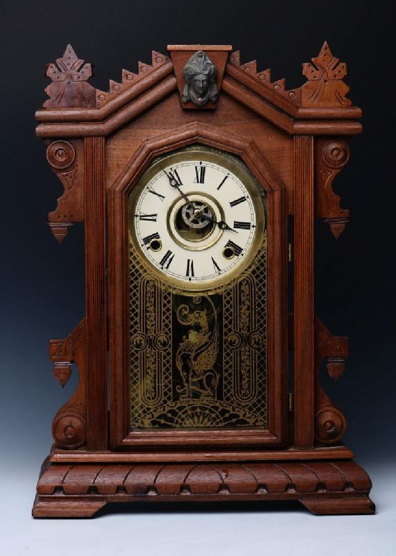 AN ORNATE WALNUT PARLOR CLOCK ATTRIBUTED INGRAHAM