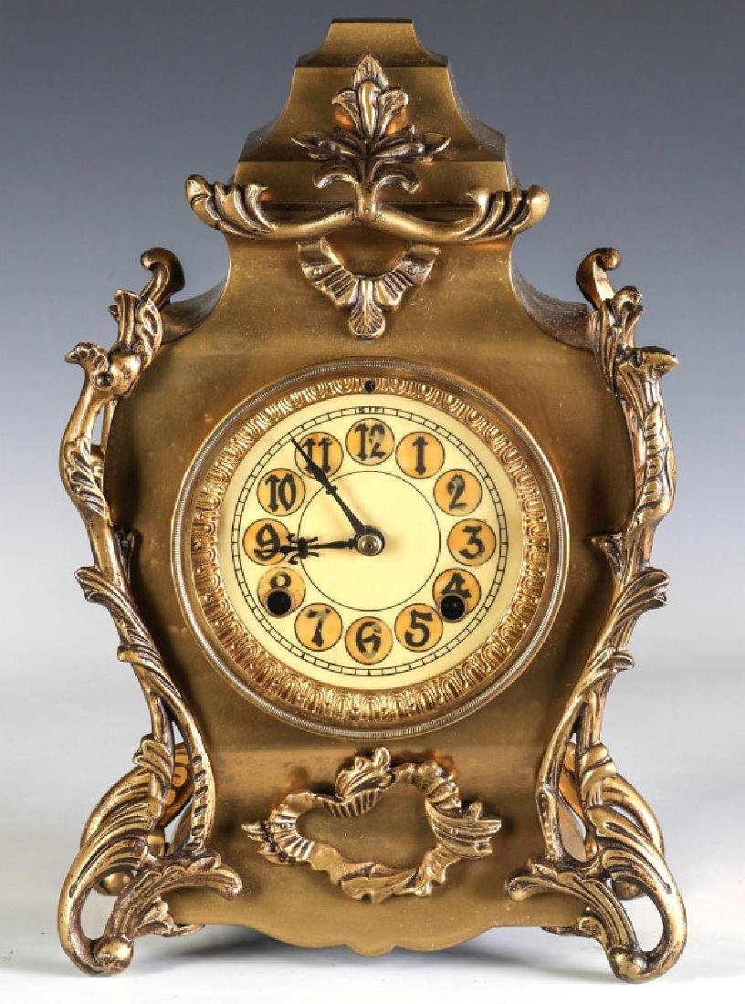 AN ORNATE NEW HAVEN BRASS CASE CLOCK