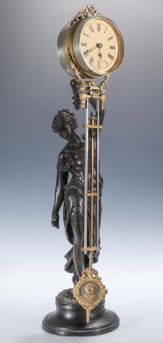 ASSEMBLED SWINGER STATUE CLOCK WITH REPRO STATUE