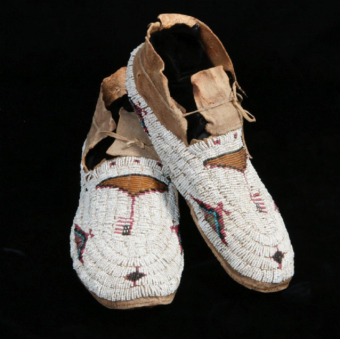 NORTHERN PLAINS BEADED MOCCASINS WITH AMERICAN FLAGS
