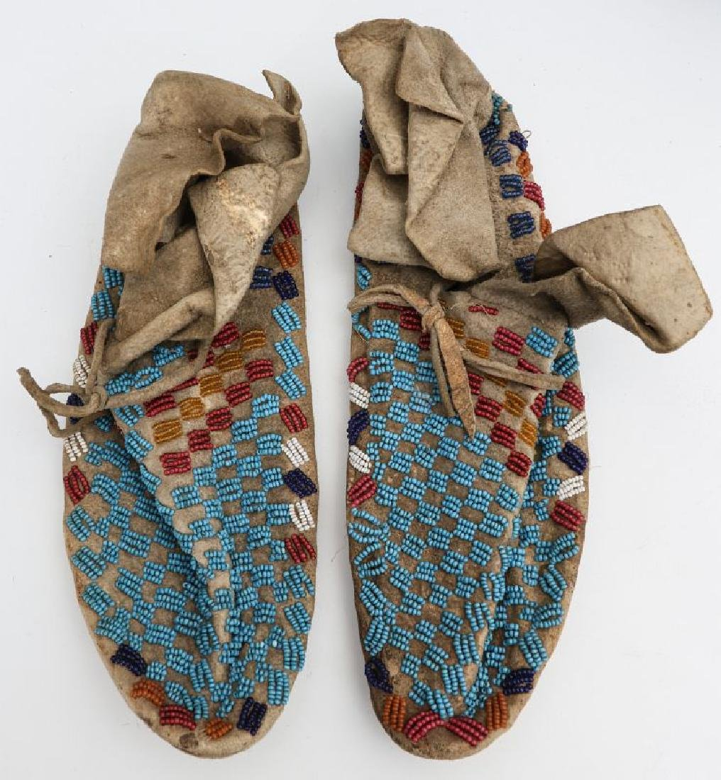 A PAIR NATIVE AMERICAN SINEW SEWN MOCCASINS C 1900 - 10