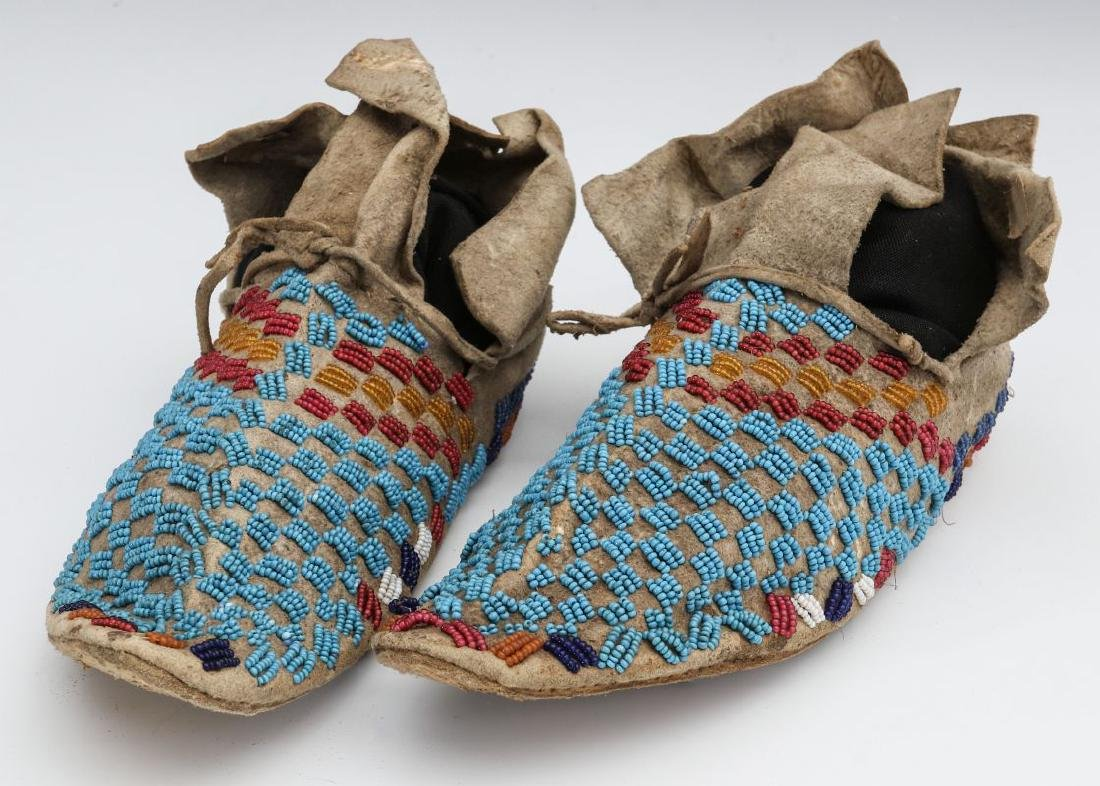A PAIR NATIVE AMERICAN SINEW SEWN MOCCASINS C 1900