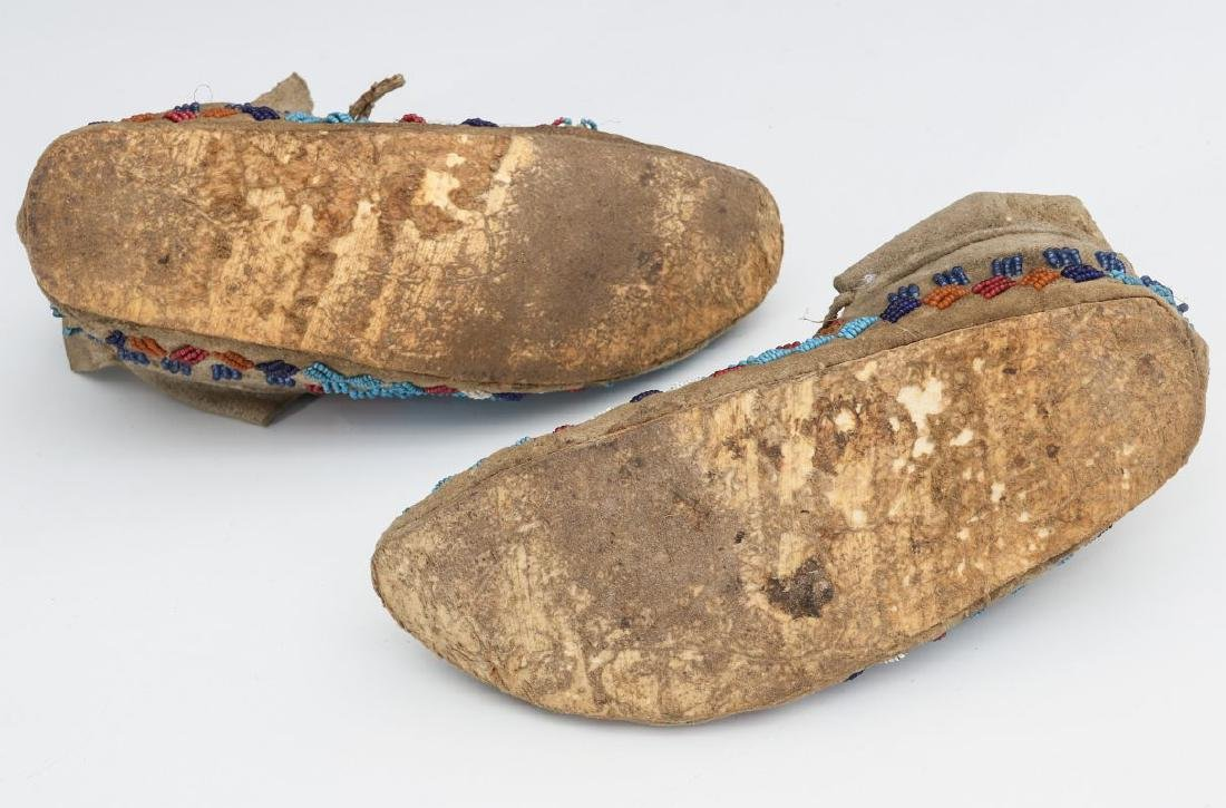 A PAIR NATIVE AMERICAN SINEW SEWN MOCCASINS C 1900 - 9