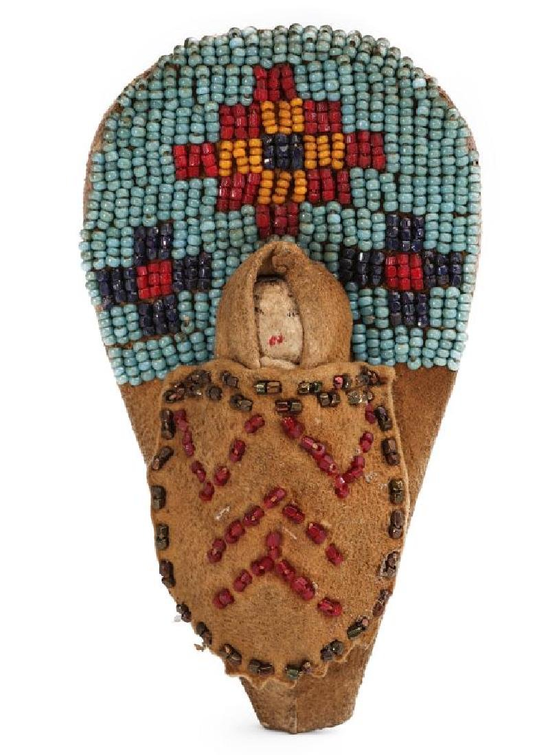 A CIRCA 1900 NATIVE AMERICAN BEADED DOLL CRADLE TOY