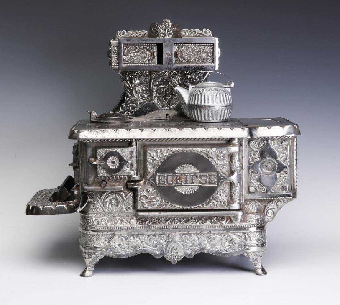 A J&E STEVENS 'ECLIPSE' ORNATE CAST IRON MIN STOVE