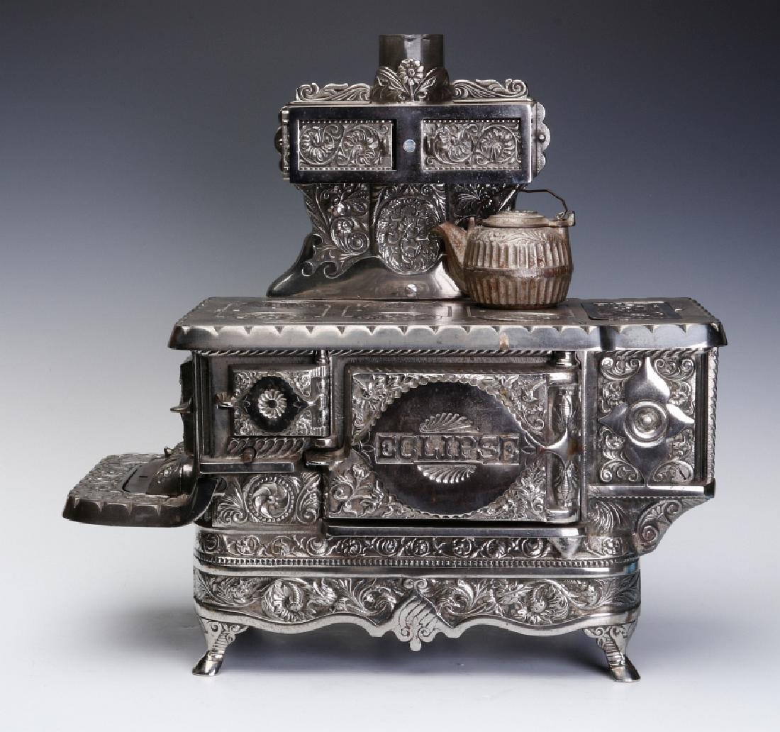 A J&E STEVENS 'ECLIPSE' CAST IRON TOY STOVE