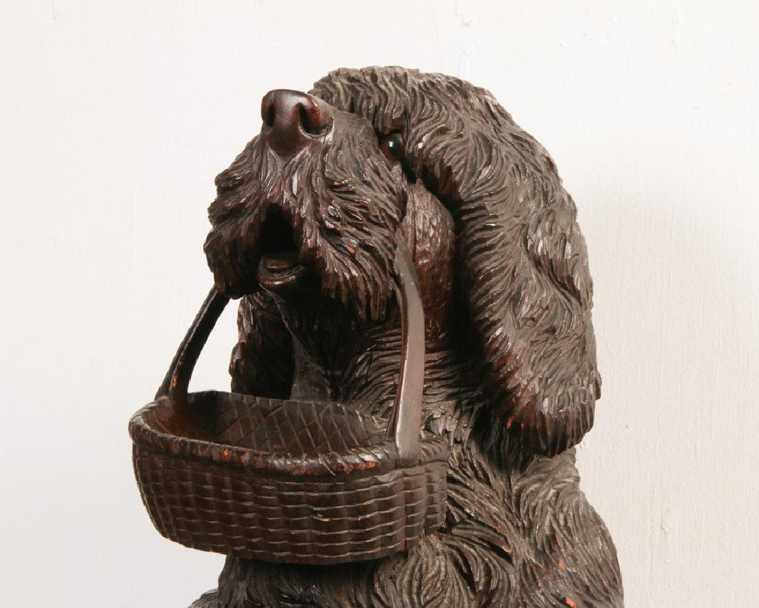 AN EARLY 20TH C BLACK FOREST CARVED DOG CANE STAND - 2
