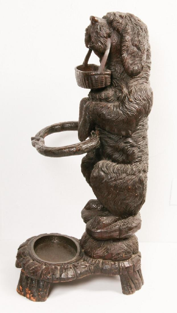 AN EARLY 20TH C BLACK FOREST CARVED DOG CANE STAND - 3