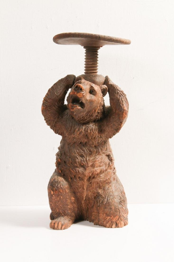 A 19TH CENTURY BLACK FOREST CARVED WOOD BEAR STAND