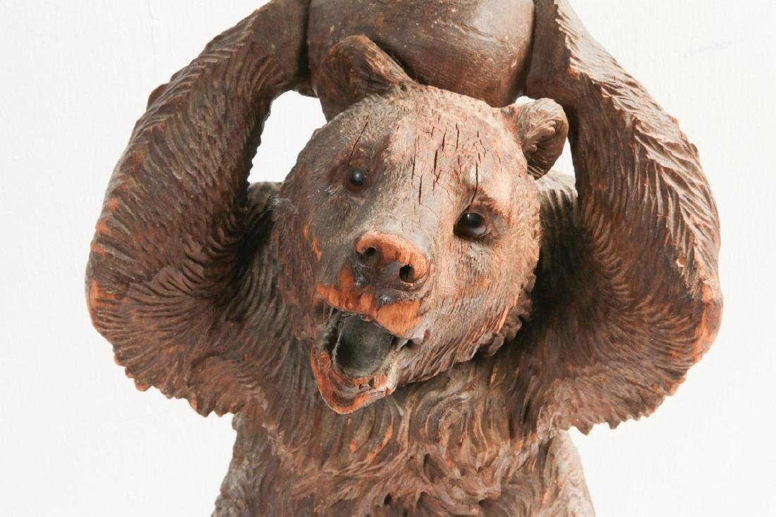 A 19TH CENTURY BLACK FOREST CARVED WOOD BEAR STAND - 2