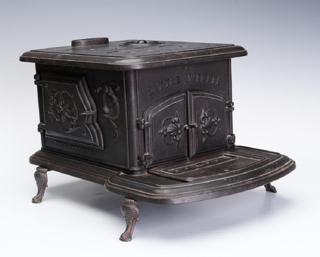 AN ABBOTT & NOBLE 'LITTLE WILLIE' CAST IRON STOVE