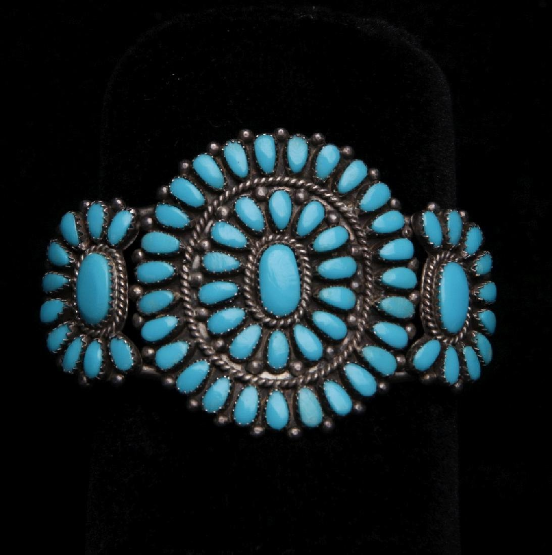 A ZUNI STERLING SILVER AND TURQUOISE CUFF BRACELET