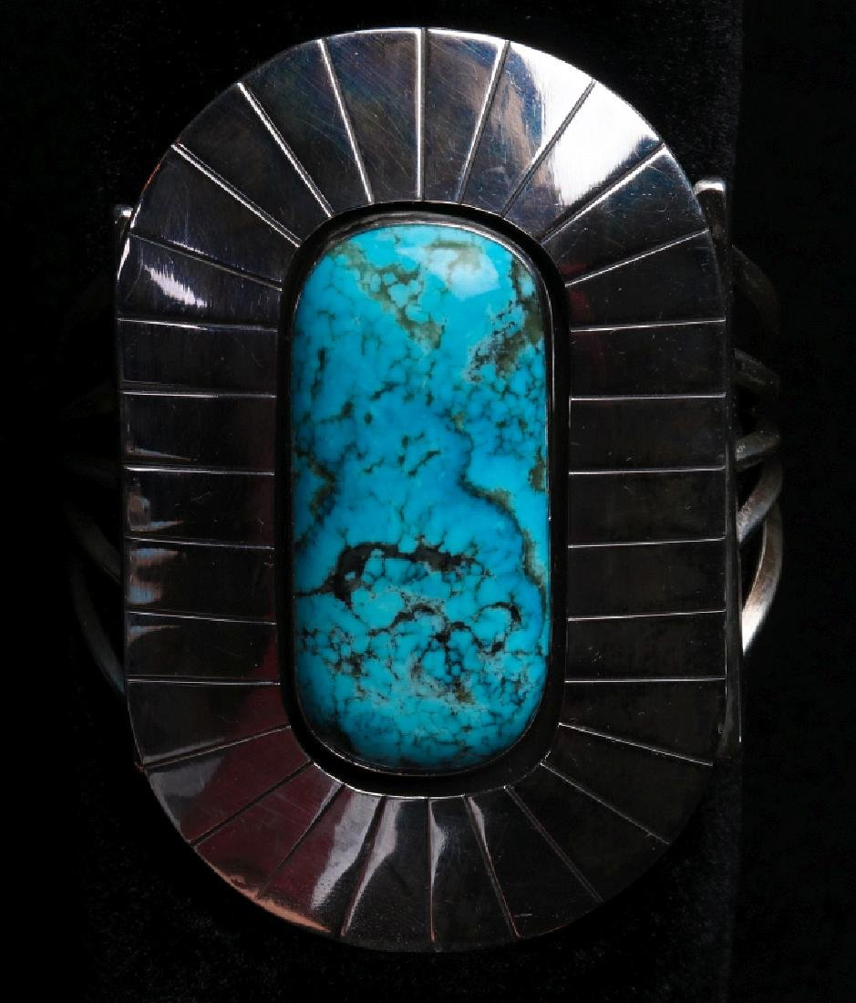 A LARGE NAVAJO STERLING & TURQUOISE CUFF BRACELET
