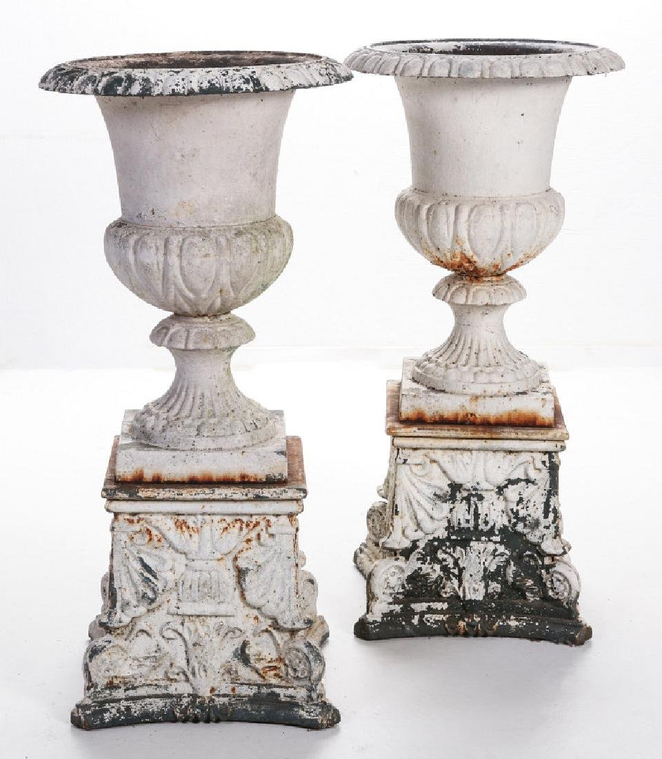 A PAIR OF CAMPAGNA FORM CAST IRON URNS ON PLINTHS - 10