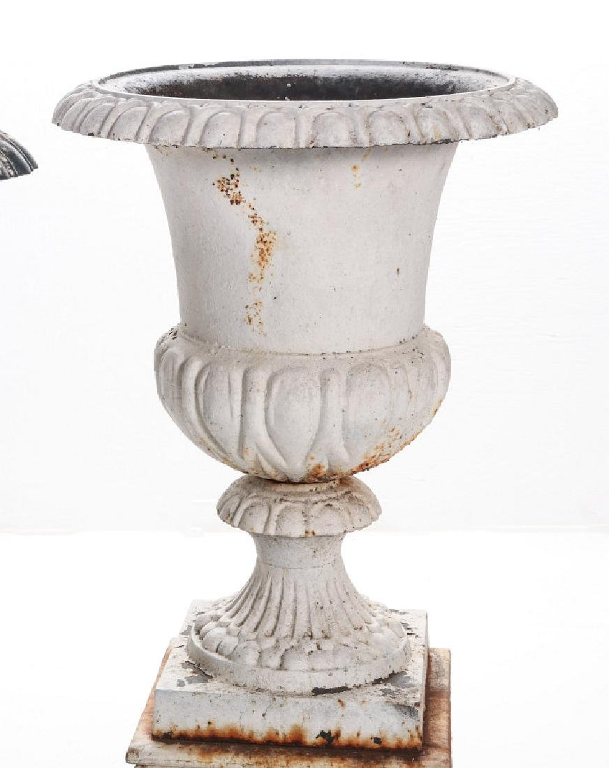 A PAIR OF CAMPAGNA FORM CAST IRON URNS ON PLINTHS - 3