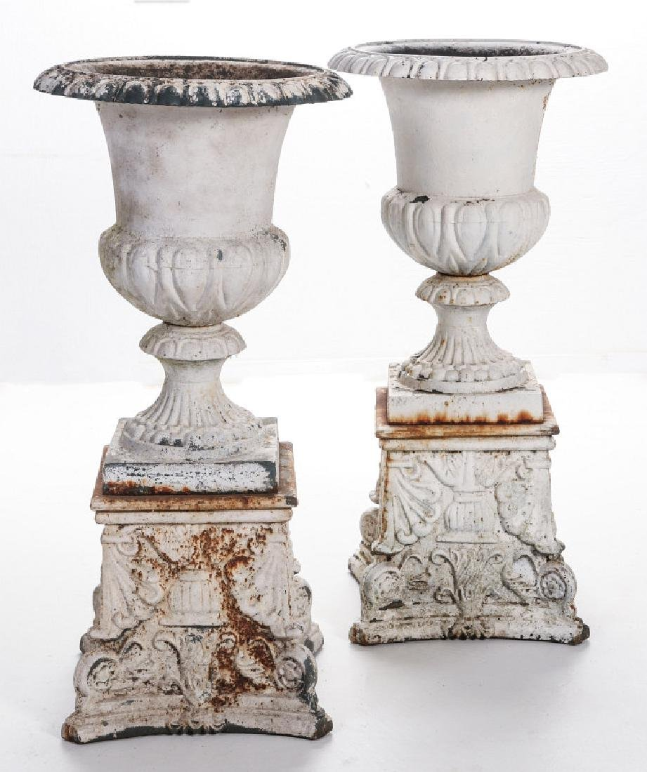 A PAIR OF CAMPAGNA FORM CAST IRON URNS ON PLINTHS - 6