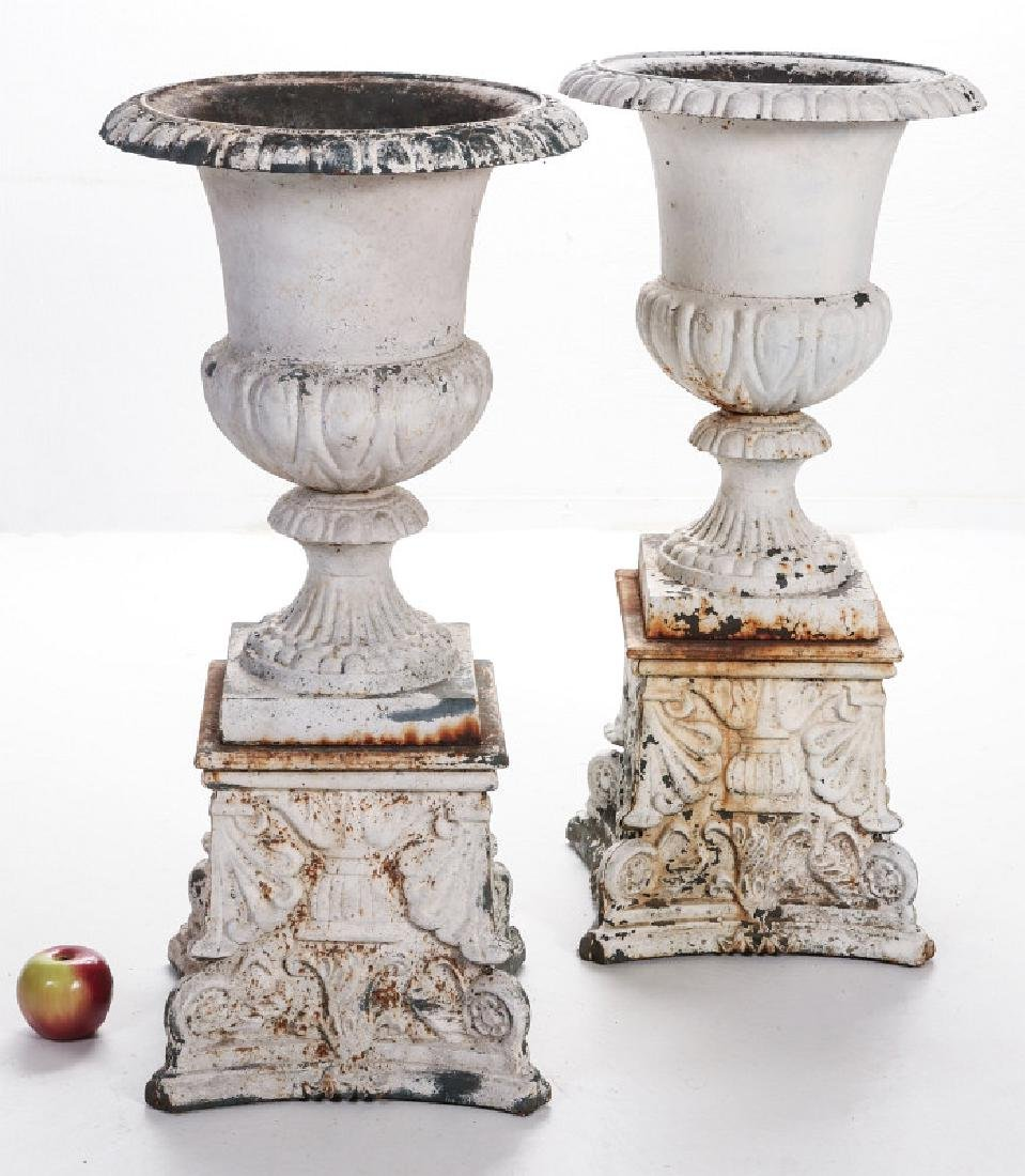 A PAIR OF CAMPAGNA FORM CAST IRON URNS ON PLINTHS - 9