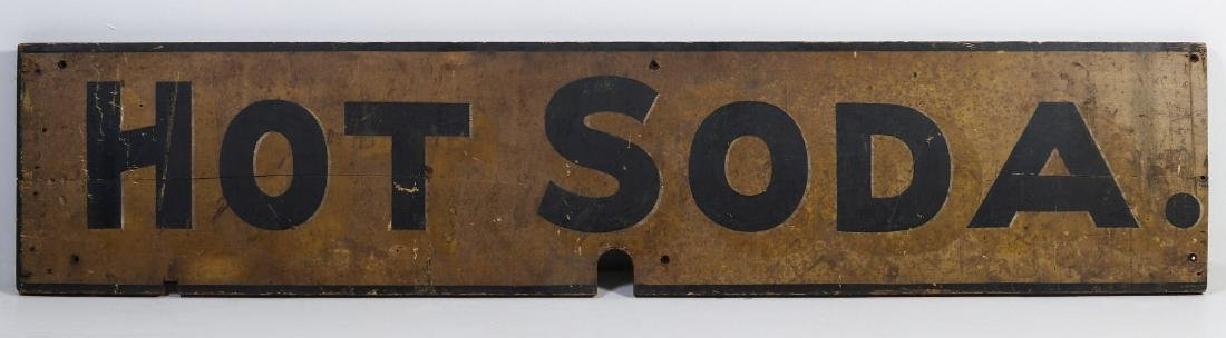 A 19TH CENTURY PAINTED WOOD SIGN FOR 'HOT SODA'