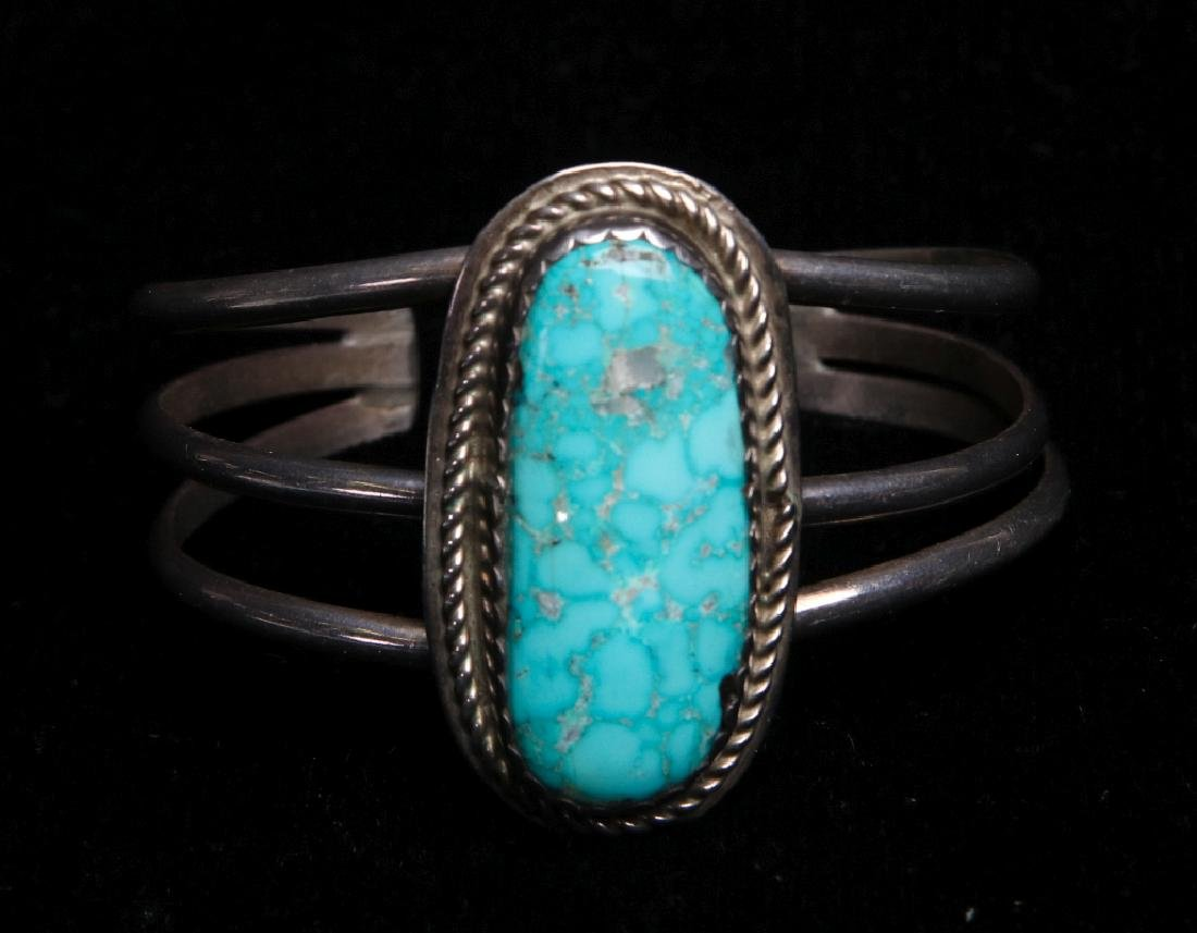 A NAVAJO STERLING AND TURQUOISE CUFF BRACELET