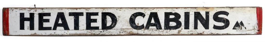 A PAINTED WOOD 'HEATED CABINS' SIGN CIRCA 1940