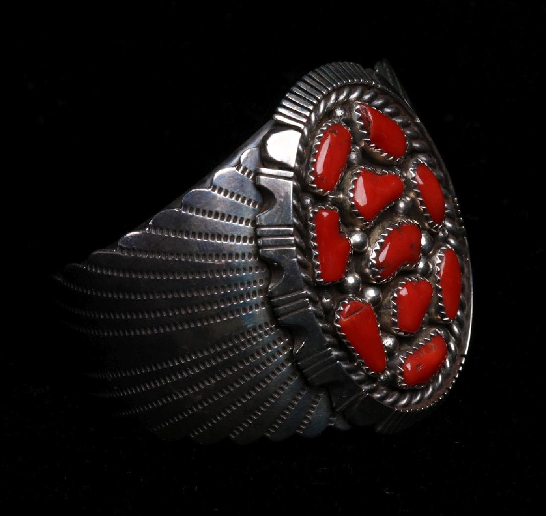 A NAVAJO STERLING AND CORAL CUFF BRACELET