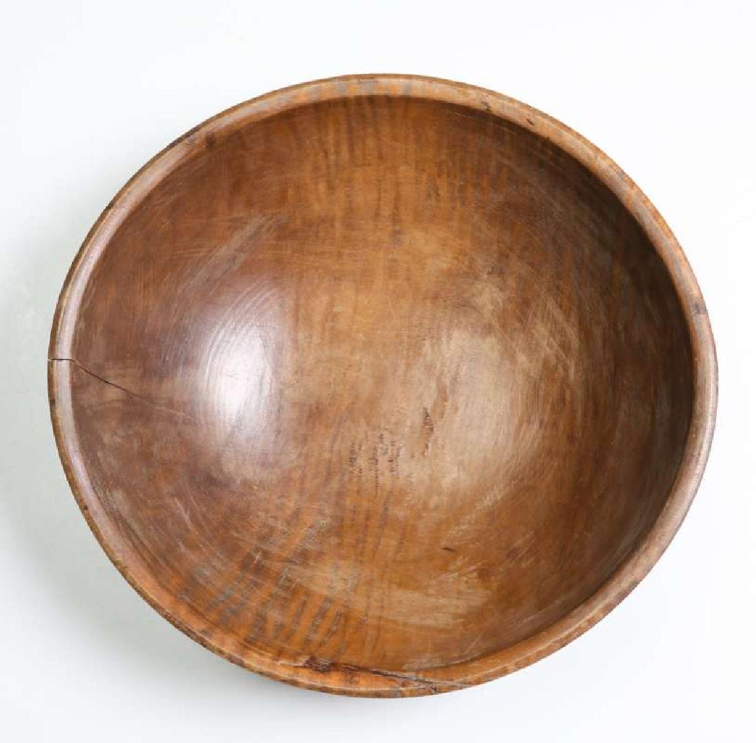 A LARGE 19TH CENTURY AMERICAN TIGER MAPLE DOUGH BOWL