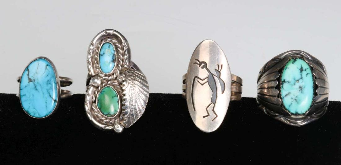 FOUR NAVAJO STERLING AND TURQUOISE RINGS