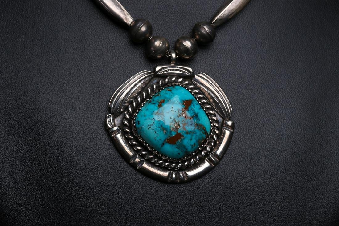 A MID 20TH C. NAVAJO STERLING & TURQUOISE PENDANT - 2