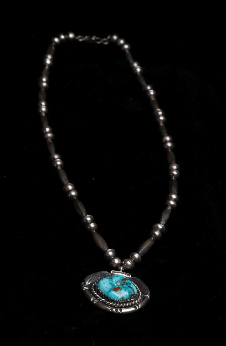 A MID 20TH C. NAVAJO STERLING & TURQUOISE PENDANT - 5