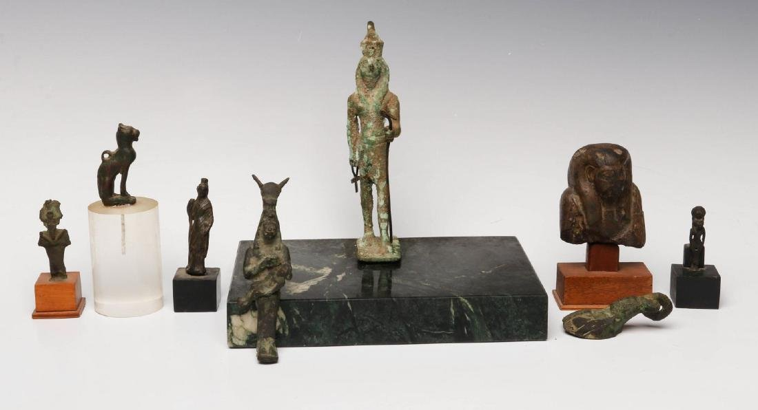 EIGHT BRONZE AND STONE ARTIFACTS OF EGYPTIAN MOTIF
