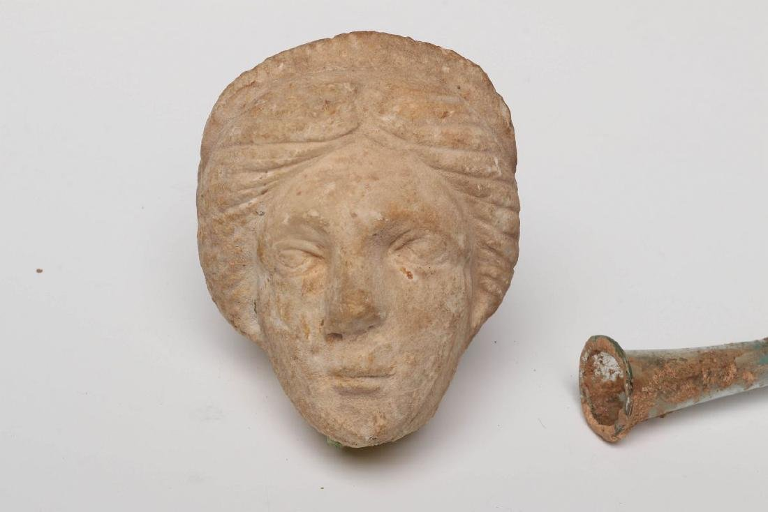 A ROMAN GLASS VASE WITH CARVED STONE HEAD - 6
