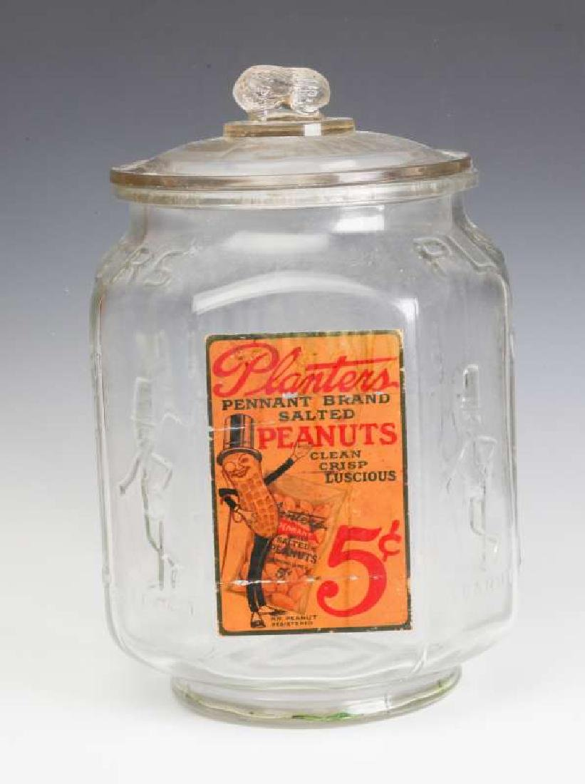 A PLANTER'S PEANUT JAR WITH 5 CENTS PAPER LABEL