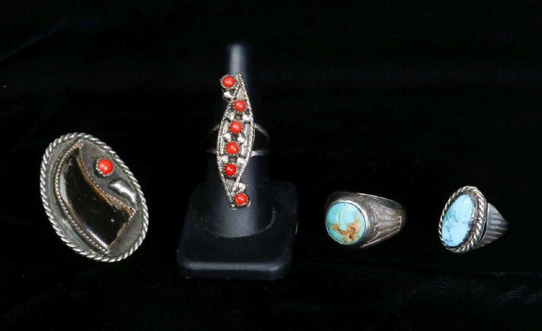 FOUR VINTAGE NAVAJO STERLING SILVER RINGS