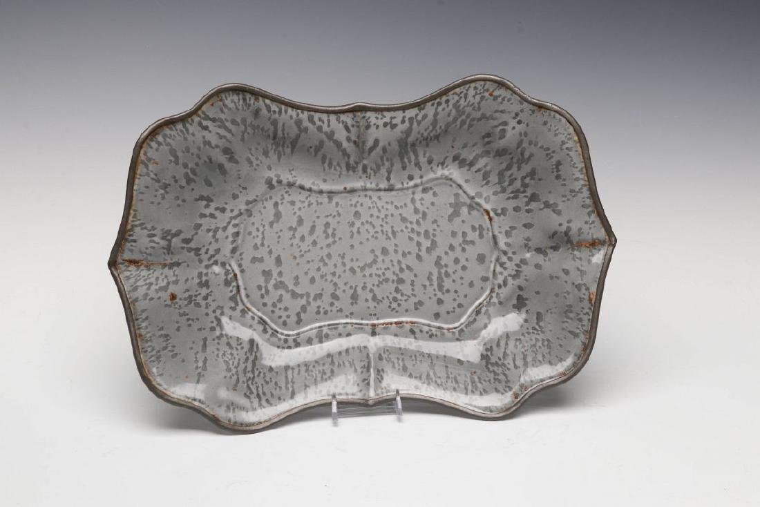 AN UNUSUAL MOLDED GRAY GRANITE BREAD TRAY