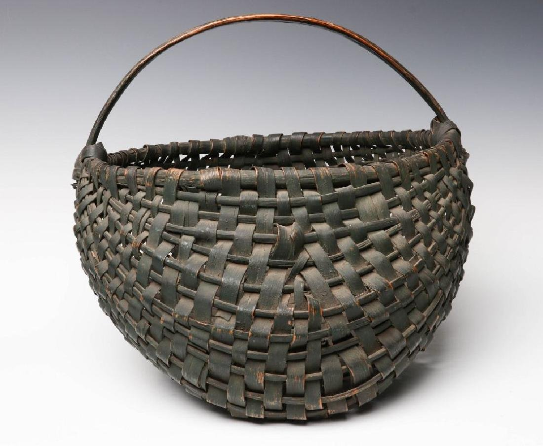 A 19TH CENTURY BUTTOCKS BASKET IN OLD GREEN PAINT - 2