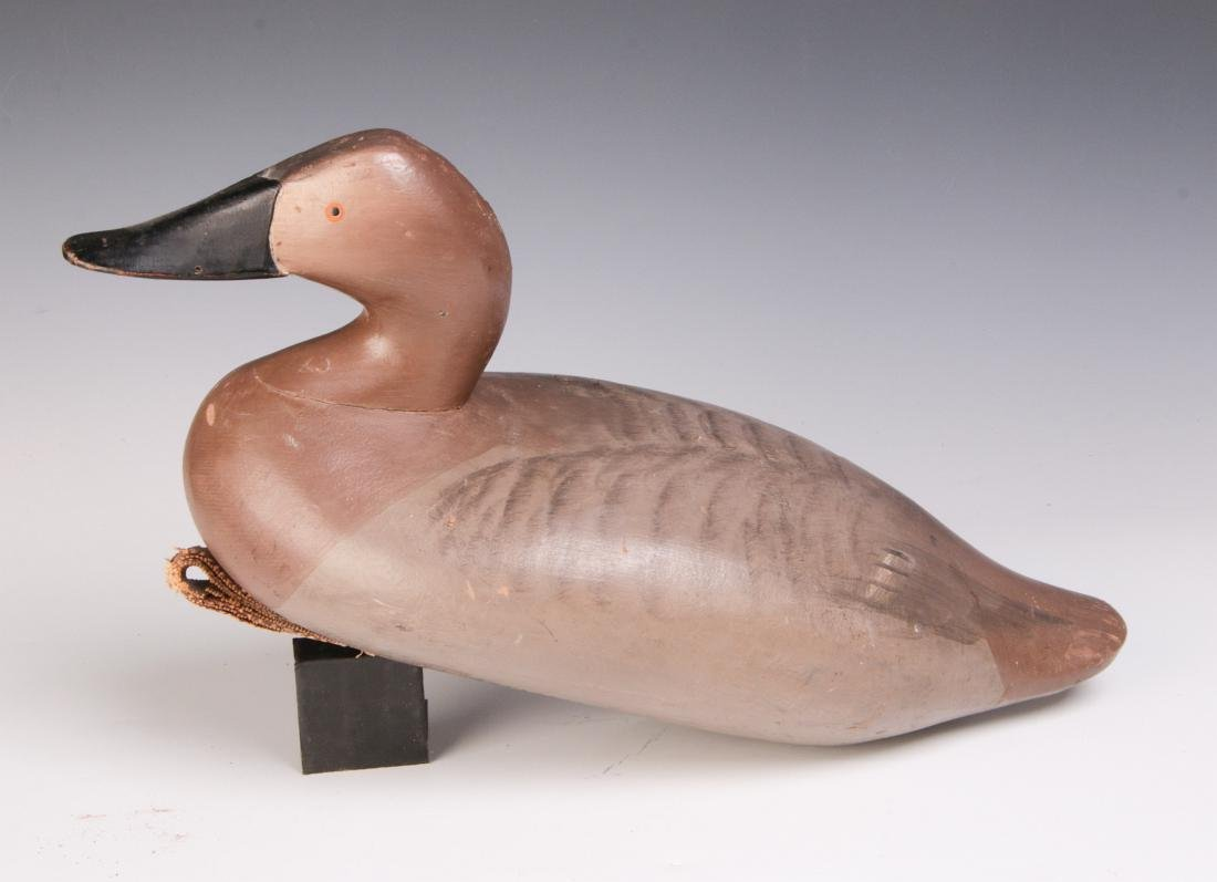 A CARVED AND PAINTED CANVAS BACK HEN DUCK DECOY