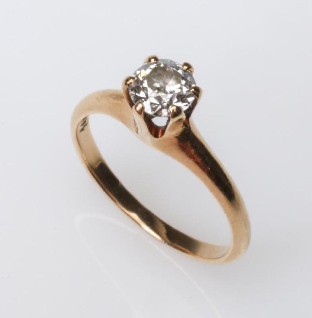 A 14K AND DIAMOND SOLITAIRE RING, APPROX .50 CT