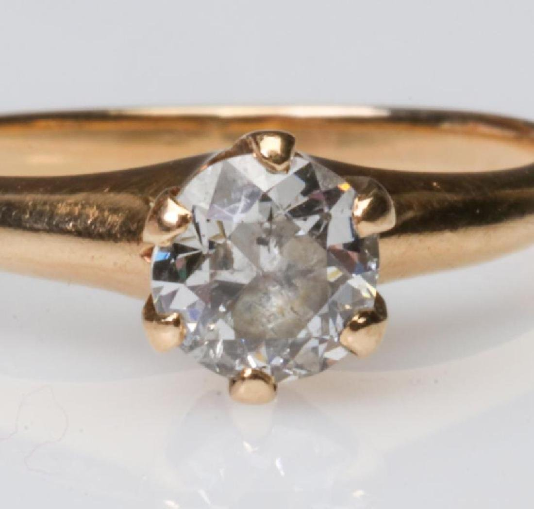 A 14K AND DIAMOND SOLITAIRE RING, APPROX .50 CT - 7
