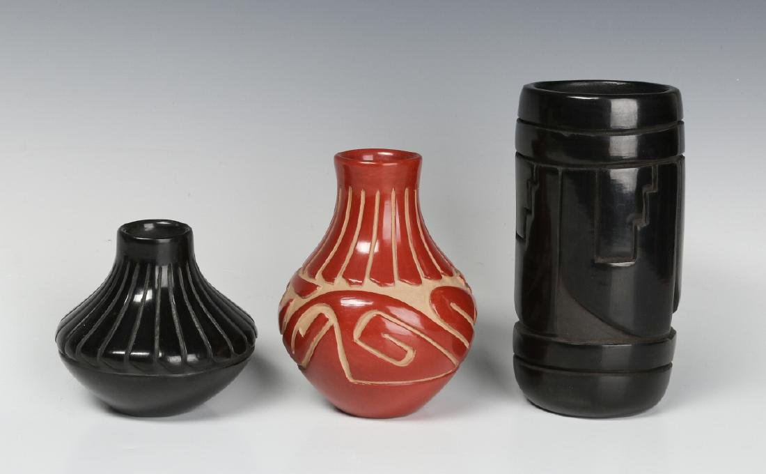 THREE CONTEMPORARY CARVED SANTA CLARA POTTERY PCS