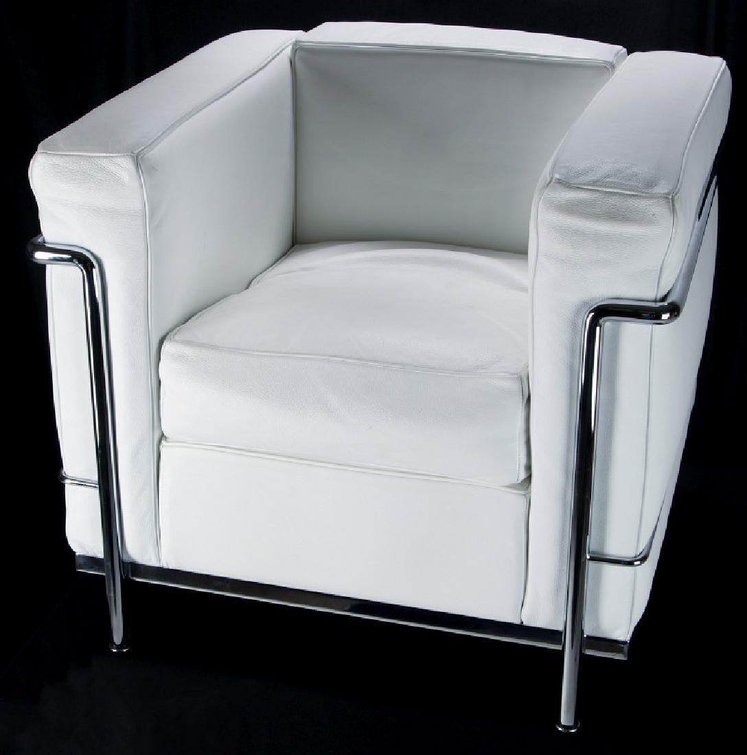 A CONTEMPORARY 'CASSINA' LC3 LEATHER ARM CHAIR