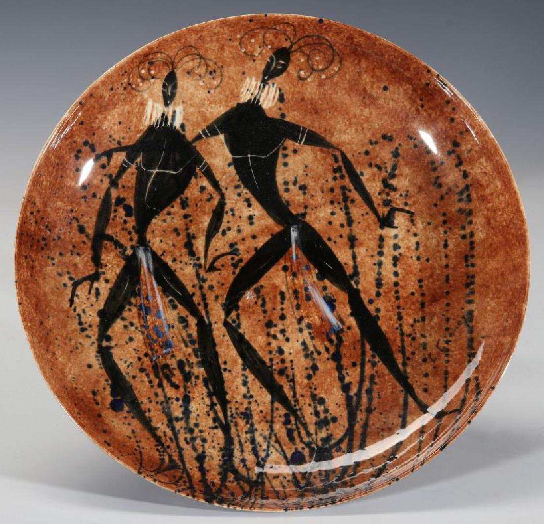 A STUDIO POTTERY CHARGER SIGNED C. CHENEY
